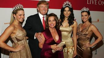 "NEW YORK - APRIL 18:  (L-R) Miss USA 2005, Chelsea Cooley, Donald Trump, President of Miss Universe, Paula Shugart, Miss Universe 2005, Natalie Glebova, and Miss Teen USA 2005, Allie LaForce attend ""Universal Beauty: The Miss Universe Guide To Beauty"" Launch at Trump Tower on April 18, 2006 in New York City. (Photo by Thos Robinson/Getty Images)"