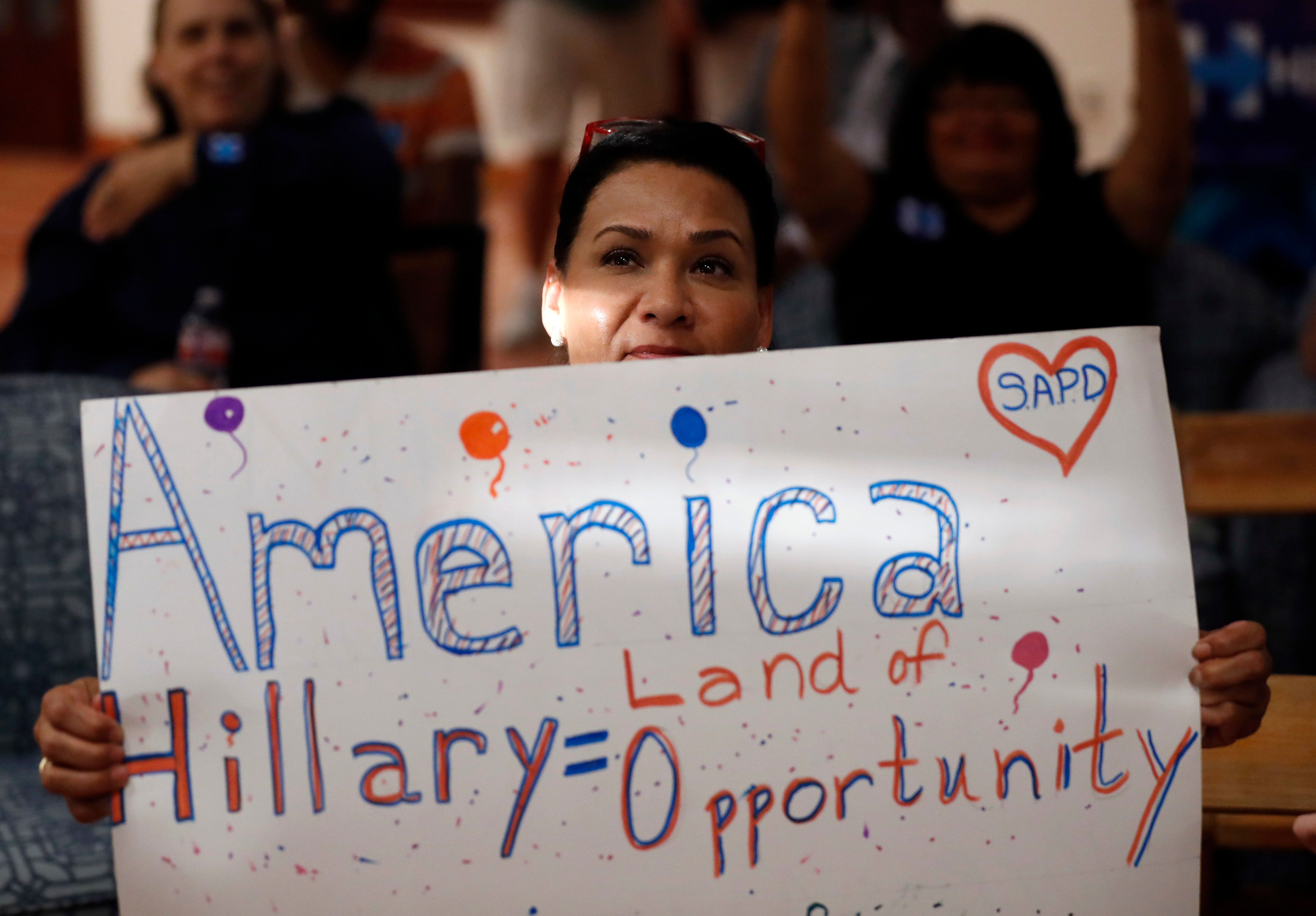 """ADVANCE FOR USE MONDAY, AUG. 8, 2016 AND THEREAFTER-A supporter of Democratic presidential candidate Hillary Clinton attends a Democratic National Convention watch party in San Antonio on Tuesday, July 26, 2016. Crystal Zermeno, director of special projects for the Democratic field organization Texas Organizing Project, says, """"For the past 15 to 20 years, weve been focusing on moving swing white voters. If you talk to Hispanic voters, they say, No one has asked me to vote'... There has not been a focus and real expenditures historically on unlikely voters, and you cant just expect non-voters to go out in great numbers ... without anyone encouraging them."""" (AP Photo/Eric Gay)"""