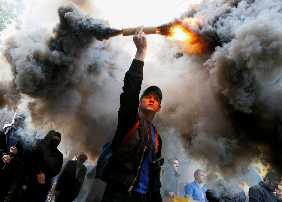 """Members of the Ukrainian national guard """"Azov"""" regiment and activists of the Azov civil corps take part in a protest against"""