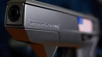 "A smart gun by Armatix is pictured at the Armatix headquarters in Munich May 14, 2014. The gun is implanted with an electronic chip that allows it to be fired only if the shooter is wearing a watch that communicates with it through a radio signal. If the gun is moved more than 10 inches (25 cm) from the watch, it will not fire. A Maryland gun shop owner has dropped his plan to be the first in the United States to sell the so-called ""smart gun"" after a backlash that included death threats.     REUTERS/Michael Dalder       (GERMANY - Tags: CRIME LAW POLITICS SCIENCE TECHNOLOGY BUSINESS)"