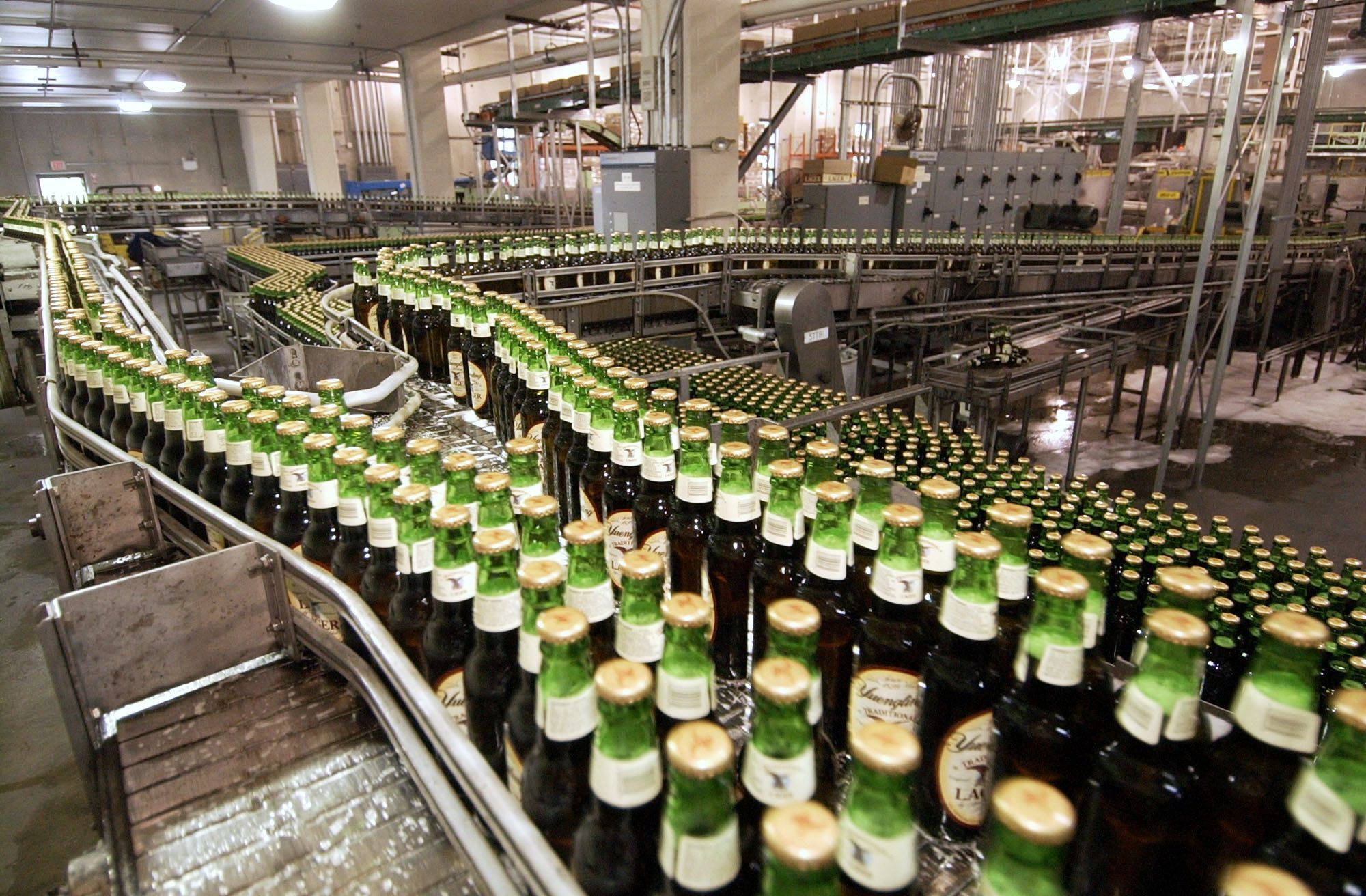 Bottles of lager move through the assembly line at the Yuengling brewery in Pottsville, Pennsylvania.