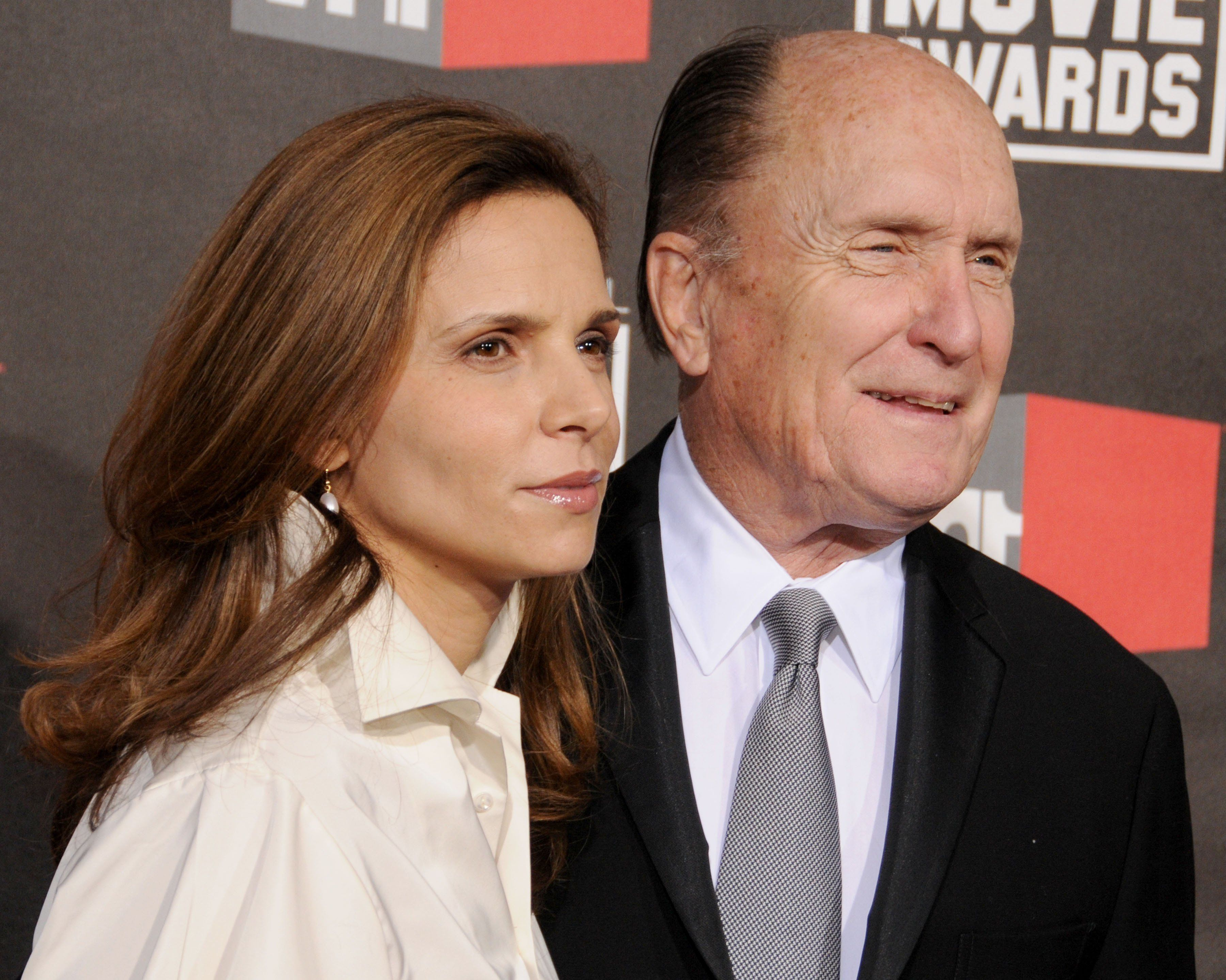 HOLLYWOOD, CA - JANUARY 14: Robert Duvall and Luciana Pedraza arrive at The 16th Annual Critics' Choice Movie Awards at the Hollywood Palladium on January 14, 2011 in Hollywood, California. (Photo by Gregg DeGuire/FilmMagic)