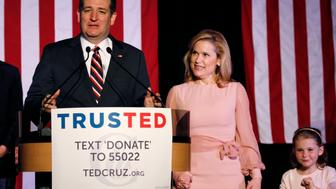 Republican U.S. presidential candidate Senator Ted Cruz is accompanied by his wife Heidi and daughter Caroline as he speaks about the primary election results in Florida, Ohio and Illinois during a campaign rally in Houston, Texas March 15, 2016.   REUTERS/Trish Badger