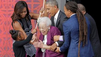 U.S. President Barack Obama and U.S. First Lady Michelle Obama along with four generations of the Bonner family ring the bell of the First Baptist Church during the dedication of the Smithsonian's National Museum of African American History and Culture in Washington, U.S., September 24, 2016.      REUTERS/Joshua Roberts