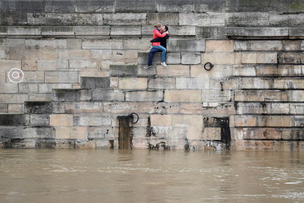 A couple kisses on the bank as high waters were causingflooding along the Seine River in Paris on June 1.