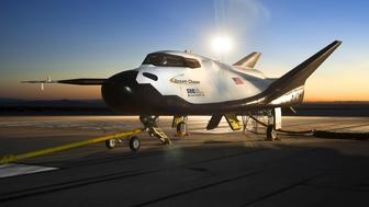 The Sierra Nevada Corporation (SNC) Dream Chaser flight vehicle is readied for 60 mph tow tests at NASA's Dryden Flight Research Center in Edwards, California, in this handout photo courtesy of Nasa taken on August 2, 2013. The privately owned prototype space plane aced its debut test flight in California but was damaged after landing when a wheel did not drop down, developer Sierra Nevada Corp said on October 29, 2013. The Dream Chaser is one of three space taxis under development in partnership with NASA to fly astronauts to the International Space Station following the retirement of the space shuttles in 2011. REUTERS/NASA/Ken Ulbrich/Handout via Reuters  (UNITED STATES - Tags: SCIENCE TECHNOLOGY ENVIRONMENT TRANSPORT) ATTENTION EDITORS - THIS IMAGE HAS BEEN SUPPLIED BY A THIRD PARTY. IT IS DISTRIBUTED, EXACTLY AS RECEIVED BY REUTERS, AS A SERVICE TO CLIENTS. FOR EDITORIAL USE ONLY. NOT FOR SALE FOR MARKETING OR ADVERTISING CAMPAIGNS