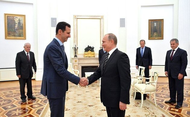 Bashar al-Assad meets with Vladimir Putin at the Kremlin Palace in Moscow, Russia, on October 21,