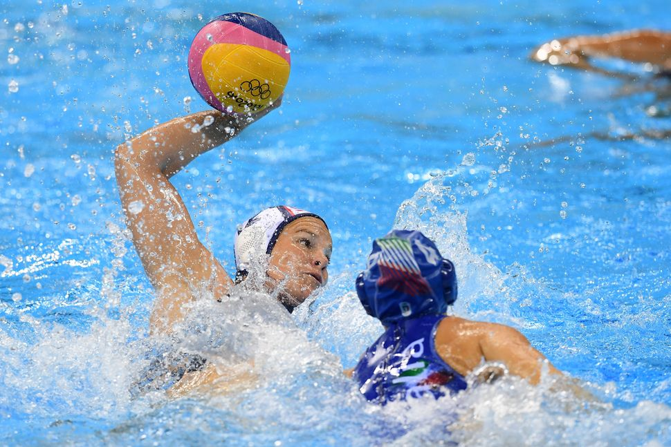 Kami Craig (white) of United States competes during the Women's Water Polo Gold Medal match between the United States an