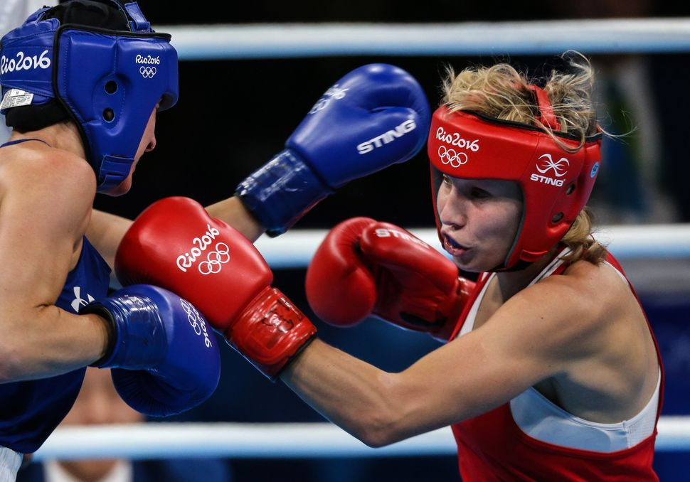 Mikaela Joslin Mayer (L) of the USA and Russia's Anastasiia Beliakova fight in their women's lightweight (57-60kg) quarterfin