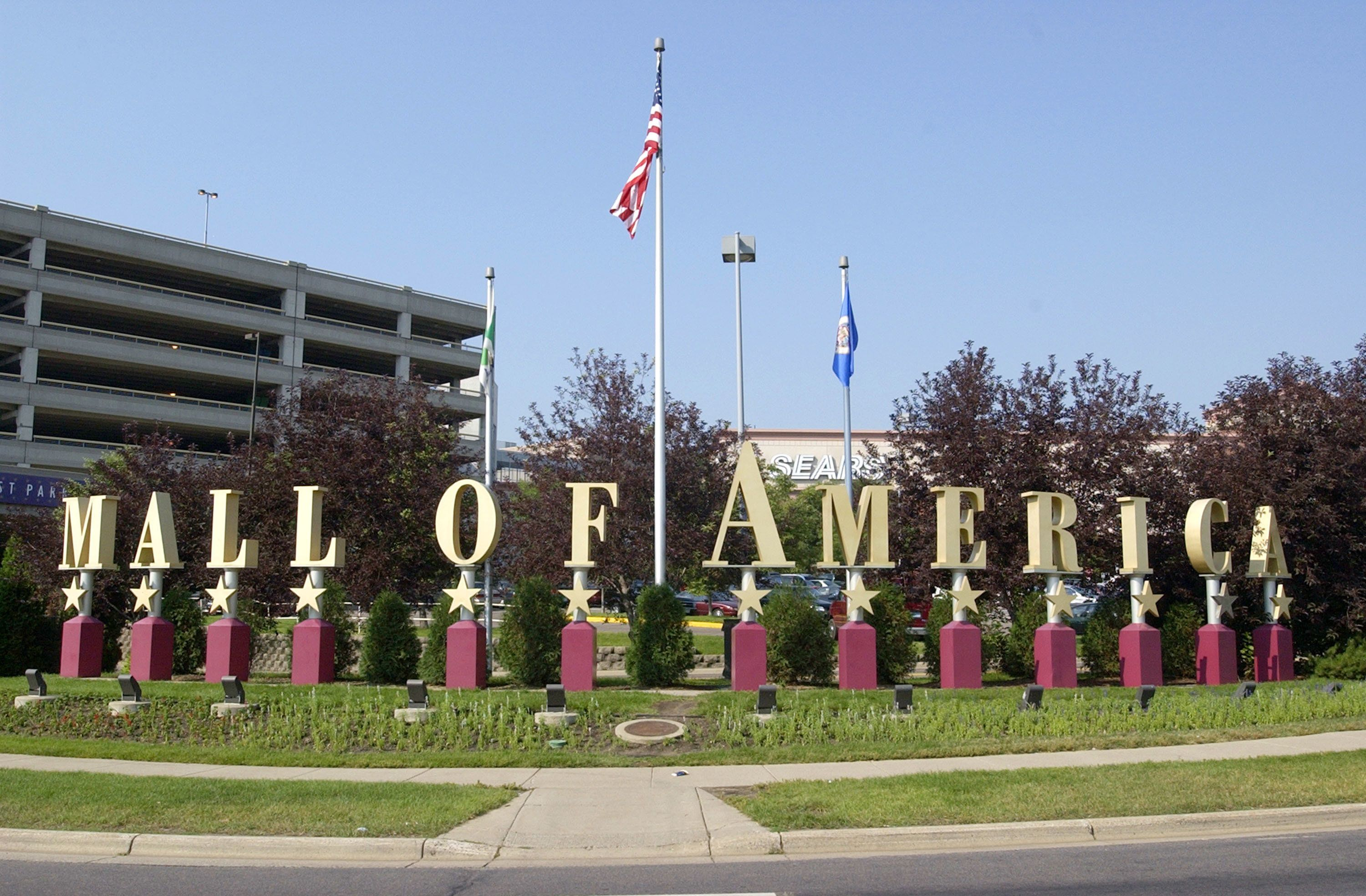 BLOOMINGTON, MN - JULY 16:  (FEATURE STORY ON THE MALL OF AMERICA, 12 OF 15)  A  sign advertises the Mall of America July 16, 2002 in Bloomington, Minnesota. The Mall of America is the largest shopping mall in the United States, seeing between 35 and 42 million visitors each year and employing more than 12,000 people.  Approximately 520 stores occupy the mall's 4.2 million square feet.  The Mall of America will celebrate its 10th anniversary this August. (Photo by Mark Erickson/Getty Images)
