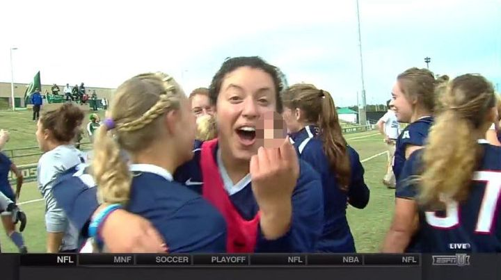 Former University of Connecticut soccer playerNoriana Radwan flips off the camera while celebrating her team winning th