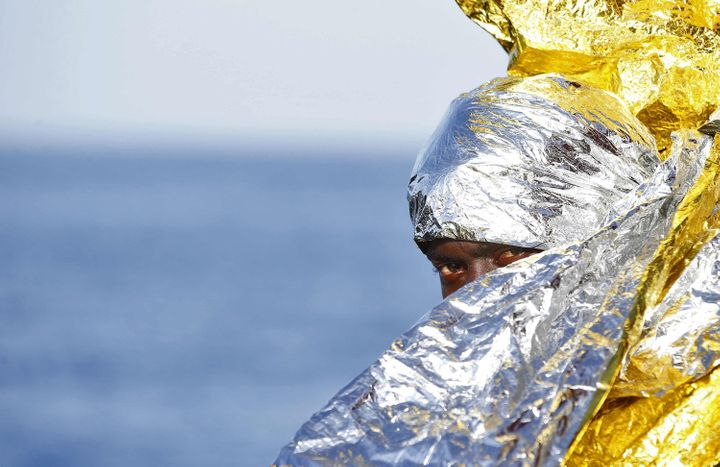 A migrant waits to disembark from the rescue vessel Responder, a rescue boat run by the Malta-based NGO Migrant Offshore Aid
