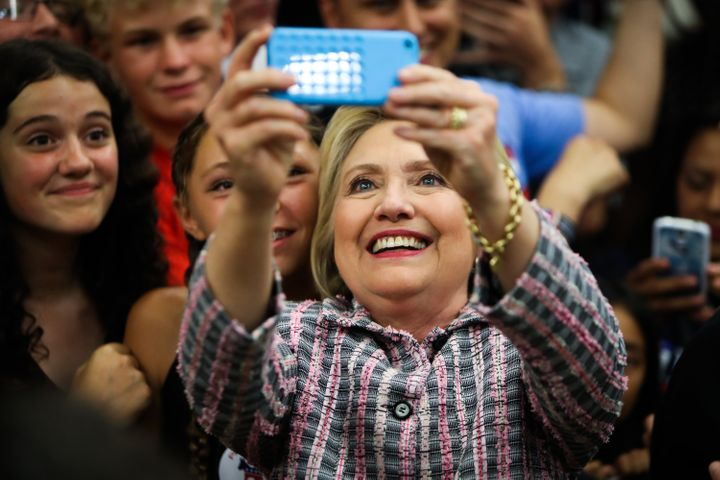 Clinton takes a selfie with supporters after a campaign rally on June 5, 2016.