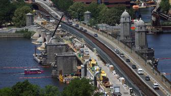 BOSTON - JUNE 24: Repairs on the Longfellow Bridge continue, including the removal of a couple of salt and pepper shaker-like towers. (Photo by David L. Ryan/The Boston Globe via Getty Images)