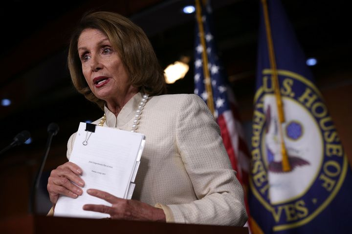 House Minority Leader Nancy Pelosi (D-Calif.) held up a copy of the Joint Comprehensive Plan of Action of the Iran nuclear deal as she announced her support for it.