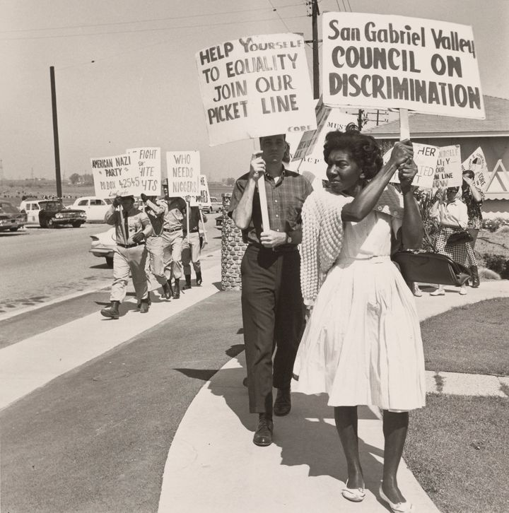 A photo of civil rights advocates picketing next to the American Nazi Party put our country's current politics into sharp relief.