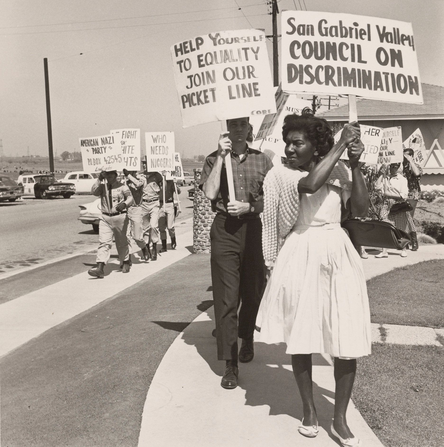 A photo of civil rights advocates picketing next to the American Nazi Party put our country's current politics into sharp rel
