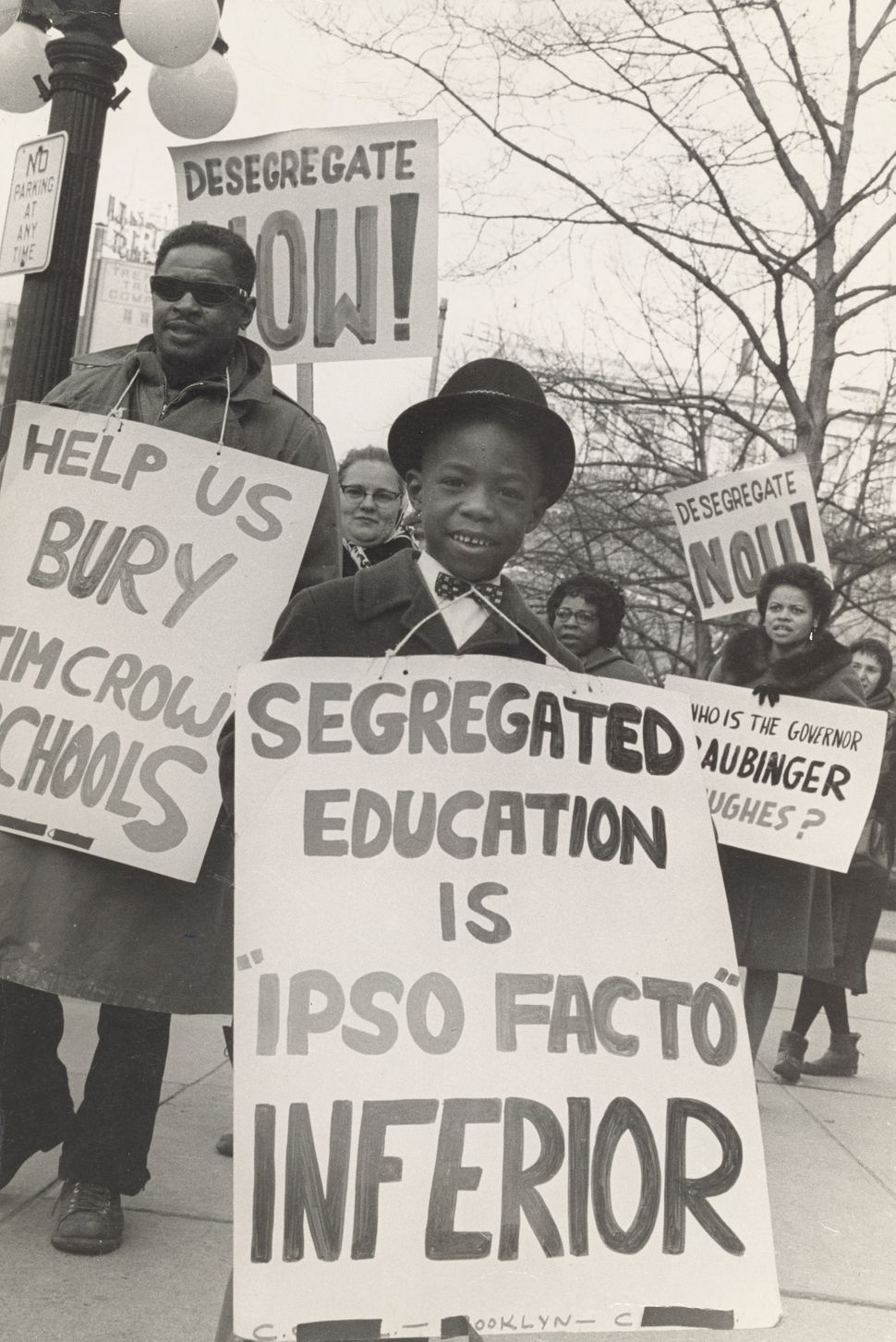 Boy picketing outside a local school, one of the many children from coast to coast who would play a critical role during the