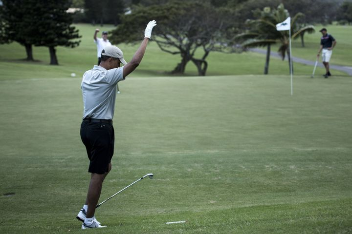 US President Barack Obama reacts on the 18th hole of the Mid-Pacific Country Club's golf course December 21, 2015 in Kailua,