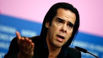 """Cast member Nick Cave talks during a news conference promoting the movie """"20,000 Days on Earth"""" at the 64th Berlinale International Film Festival in Berlin February 10, 2014. REUTERS/Thomas Peter (GERMANY - Tags: ENTERTAINMENT)"""