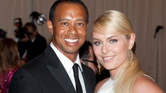 Tiger Woods and Lindsay Vonn attend the Costume Institute Gala for the 'PUNK: Chaos to Couture' exhibition at the Metropolitan Museum of Art in New York City. �� LAN (Photo by Lars Niki/Corbis via Getty Images)