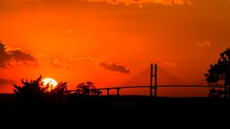 SEA ISLAND, GEORGIA - NOVEMBER 19: The sun sets over the Sidney Lanier Bridge as seen from The RSM Classic at Sea Island Resort Seaside Course on November 19, 2016 in Sea Island, Georgia. (Photo by Ryan Young/PGA TOUR)