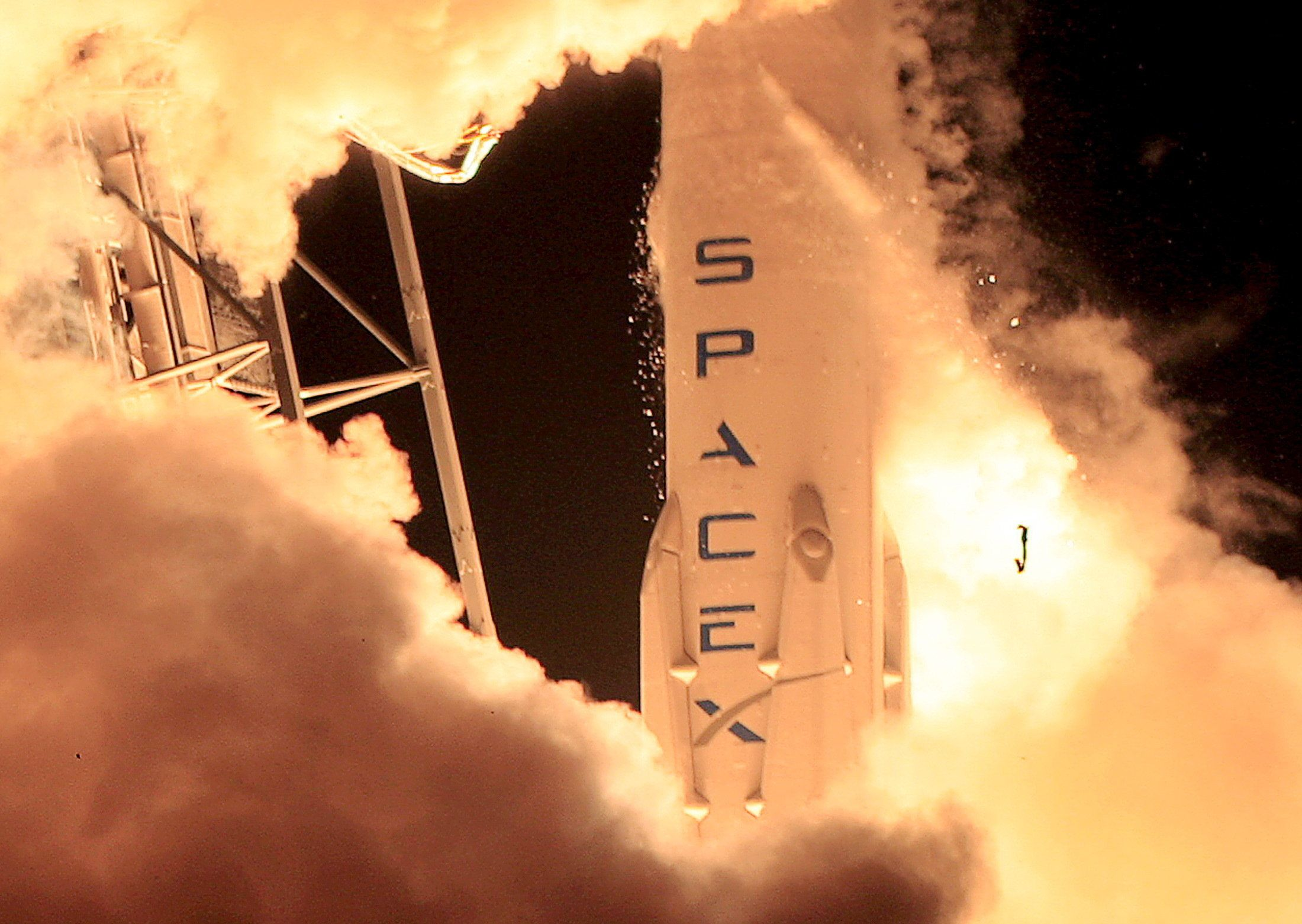 A remodeled version of the SpaceX Falcon 9 rocket lifts off at the Cape Canaveral Air Force Station on the launcher's first mission since a June failure in Cape Canaveral, Florida, December 21, 2015. The rocket carried a payload of eleven satellites owned by Orbcomm, a New Jersey-based communications company. The first stage returned to land following launch.  REUTERS/Joe Skipper