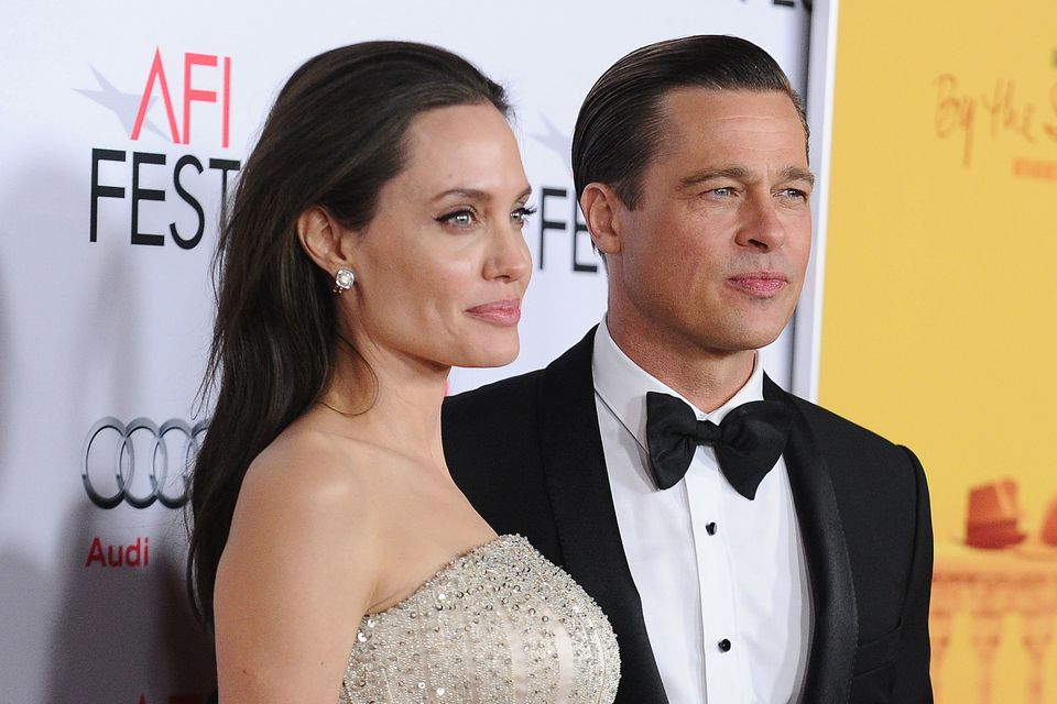 "The couple, who were together for 11 years and married for two, <a href=""http://www.huffingtonpost.com/entry/angelina-jolie-a"