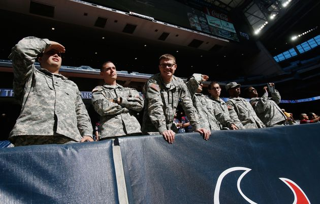 Servicemen are seen in the stands on Salute to Service Day prior to the start of the game between the...