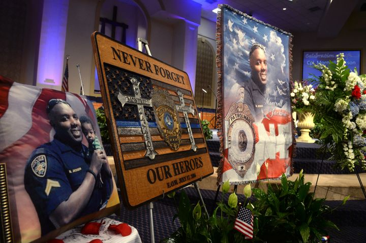 BATON ROUGE, LA - JULY 25: Signs and photos are displayed during the funeral of Baton Rouge police corporal Montrell Jackson