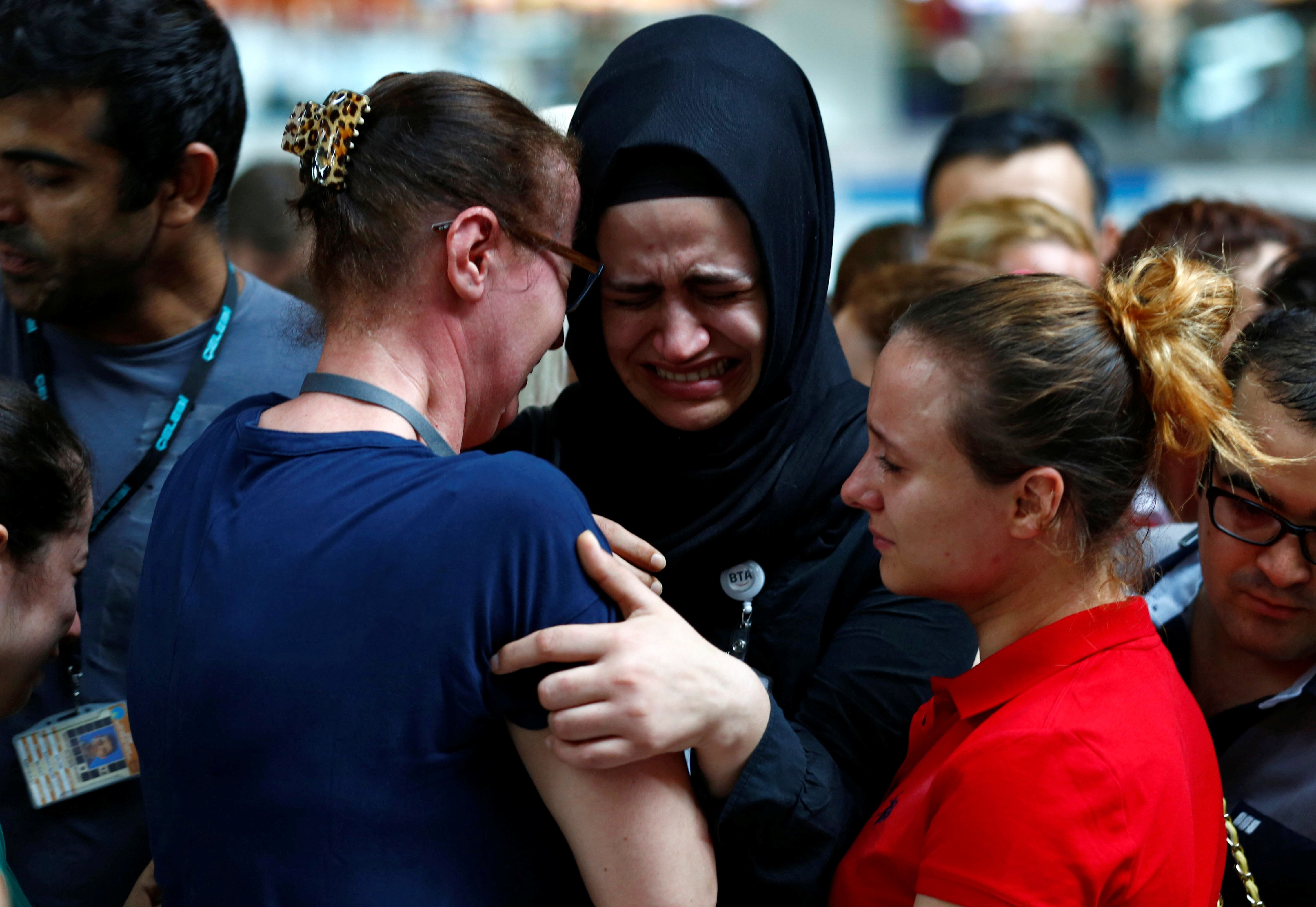 Airport employees mourn for their friends, who were killed in Tuesday's attack at the airport, during a ceremony at the international departure terminal of Ataturk airport in Istanbul, Turkey, June 30, 2016. REUTERS/Murad Sezer