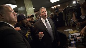 Head of the Patrolmen's Benevolent Association of the City of New York Patrick Lynch addresses media following the arraignment of Tyrone Howard for the shooting death of New York Police Officer Randolph Holder at the Manhattan criminal court in New York, October 21, 2015. Howard allegedly shot and killed Holder late on Tuesday while being pursued by police close to a busy road in the city's East Harlem neighborhood, police said on Tuesday. REUTERS/Andrew Kelly