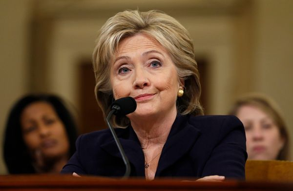 Democratic presidential candidate Hillary Clinton listens to a question as she testifies before the House Select Committee on