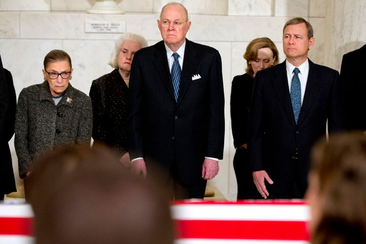 Supreme Court Justices Ruth Bader Ginsburg, left, Anthony M. Kennedy, and Chief Justice John G. Roberts, Jr., attend a privat