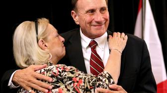Incumbent congressman John Mica of Florida's 7th congressional district gets a hug from his wife, Patrica, after conceding defeat to Democratic challenger Stephanie Murphy, at the Republican Party of Seminole County, Fla. Election Watch event in Altamonte Springs near Orlando, Tuesday, Nov. 8, 2016.  (Joe Burbank/Orlando Sentinel/TNS via Getty Images)
