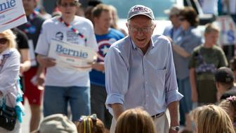 Democratic presidential hopeful Sen. Bernie Sanders (D-VT) shakes hands during the Independence Day Parade in Creston, Iowa July 4, 2015.  REUTERS/Scott Morgan
