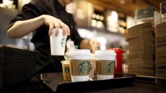 A staff serves beverages at a Starbucks coffee shop in Seoul, South Korea, in this March 7, 2016, file photo. REUTERS/Kim Hong-Ji/Files  GLOBAL BUSINESS WEEK AHEAD PACKAGE - SEARCH 'BUSINESS WEEK AHEAD APRIL 18'  FOR ALL IMAGES