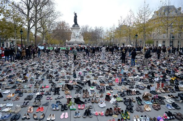 PARIS, FRANCE - NOVEMBER 29:  General view of Place de le Republique which is covered with shoes as part of symbolic rally or