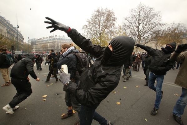 PARIS, FRANCE - NOVEMBER 29: Demonstrators fight with police during the forbidden COP21 demonstration on November 29, 2015 in
