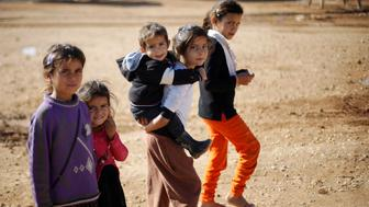 Syrian refugee children play at Al Zaatari refugee camp in Jordan near the border with Syria, December 3, 2016. REUTERS/Muhammad Hamed