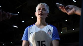 US women's soccer team midfielder Megan Rapinoe (C) speaks to the media wearing a jersey made by Nike during an unveiling event in New York on March 17, 2016. / AFP / Jewel SAMAD        (Photo credit should read JEWEL SAMAD/AFP/Getty Images)