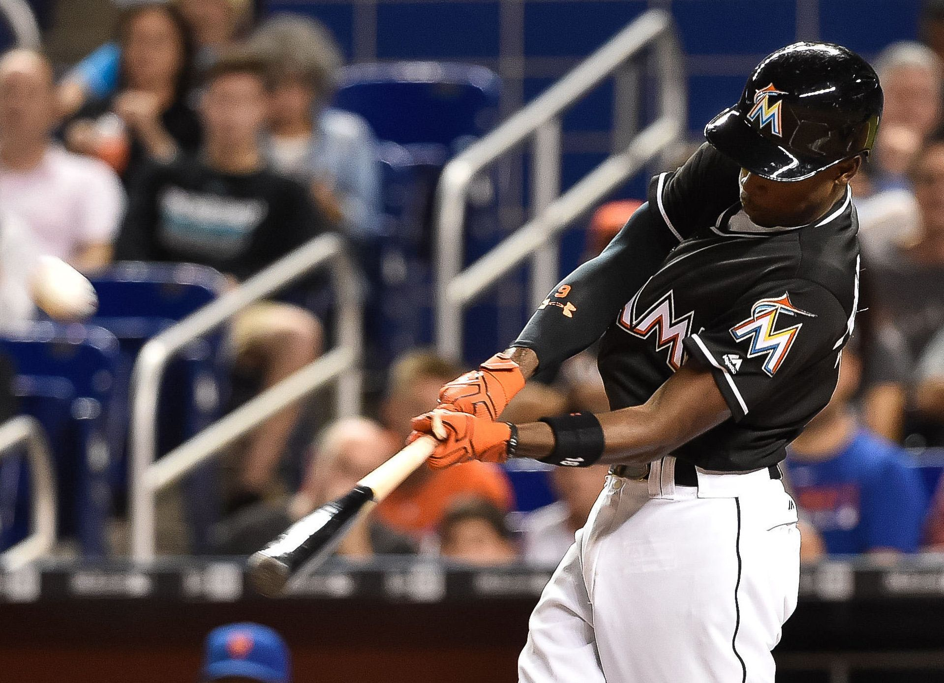 Sep 26, 2016; Miami, FL, USA; Miami Marlins second baseman Dee Gordon connects for a solo home run during the first inning against the New York Mets at Marlins Park. Mandatory Credit: Steve Mitchell-USA TODAY Sports