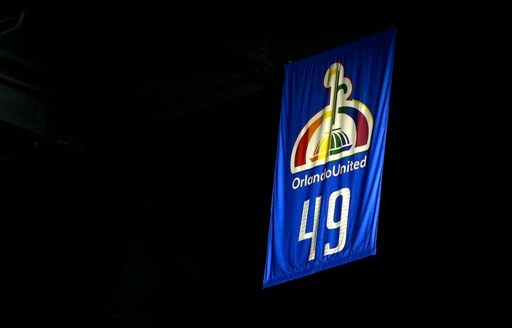 Orlando Magic raise a banner displaying the number 49 to commemorate the lives lost in the Pulse nightclub shooting before th