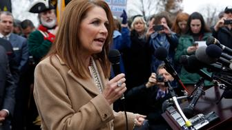 """U.S. Rep. Michele Bachmann (R-MN) speaks to the press about the need """"To Defund the President's Executive, Unconstitutional Amnesty"""" on Capitol Hill in Washington, December 3, 2014. King, Bachmann and Cruz say that President Obama has violated the U.S. Constitution by moving to shield some 4.7 million undocumented residents from deportation. REUTERS/Yuri Gripas (UNITED STATES - Tags: POLITICS BUSINESS SOCIETY IMMIGRATION)"""