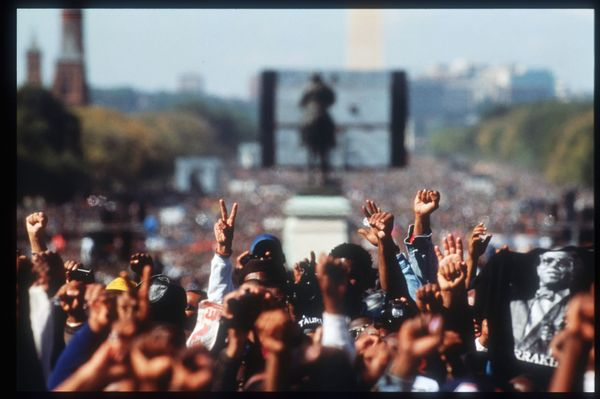 239824 04: Attendees at the Million Man March raise their hands in fists and peace/victory signs October 16, 1995 in Washingt