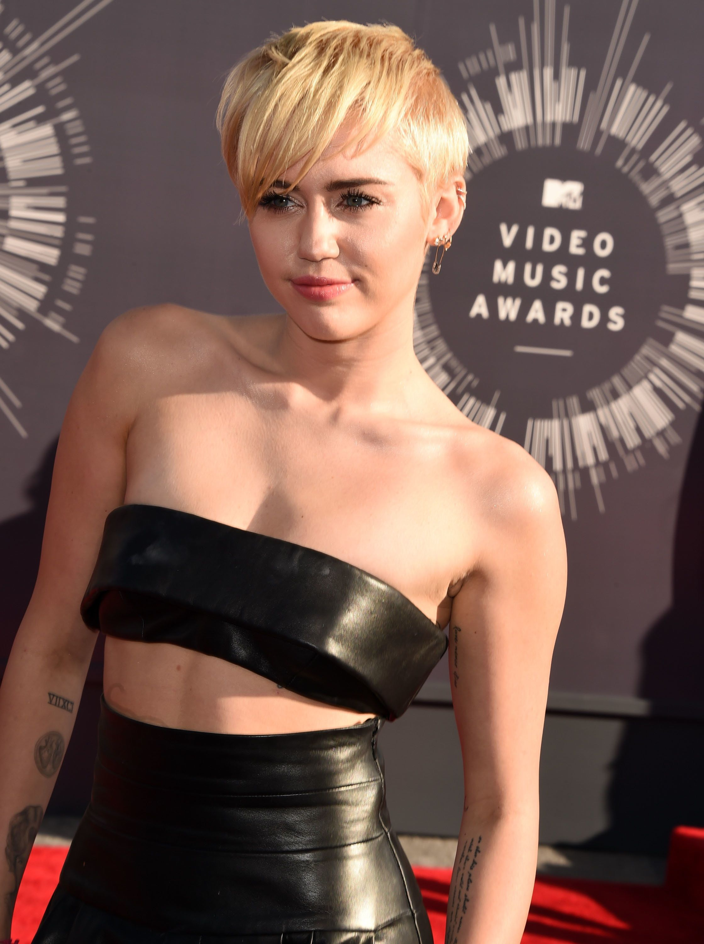 INGLEWOOD, CA - AUGUST 24:  Miley Cyrus arrives at the 2014 MTV Video Music Awards at The Forum on August 24, 2014 in Inglewood, California.  (Photo by Steve Granitz/WireImage)
