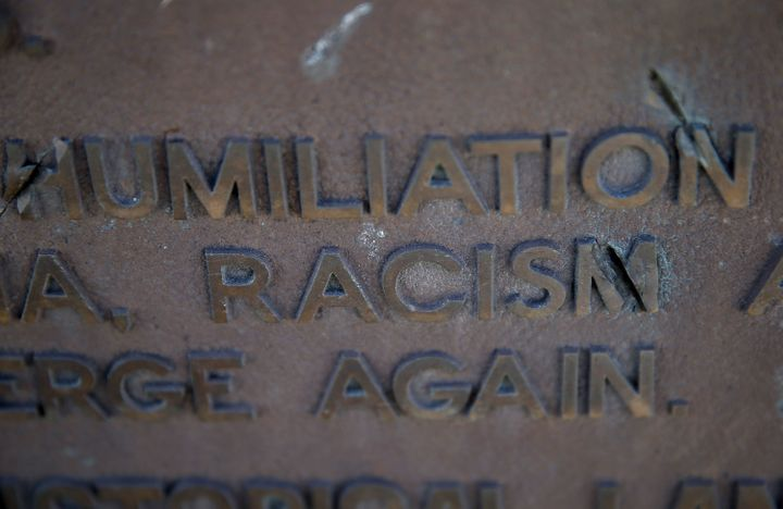 The words racism and humiliation are shown on a plaque at Manzanar National Historic Site on December 9, 2015 near Independen
