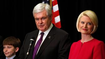 U.S. Republican presidential candidate and former Speaker of the House Newt Gingrich stands with his grandson Robert (R) and his wife Callista (R), as he explains why he is suspending his campaign for the 2012 Republican presidential nomination during an event in Arlington, Virginia, May 2, 2012.   REUTERS/Larry Downing    (UNITED STATES - Tags: POLITICS ELECTIONS)