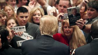 U.S. Republican presidential candidate Donald Trump greets supporters after a rally at the Westin Hilton Head Island Resort and Spa in Hilton Head Island, South Carolina, December 30, 2015.  REUTERS/Randall Hill