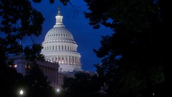 The U.S. Capitol Building stands in Washington, D.C., U.S., before sunrise on Tuesday, July 29, 2014. Democrats in Congress are trying again to prevent the federal government from awarding contracts to companies that save taxes by moving their legal addresses outside the U.S. So-called inversions are transactions in which a U.S. company shifts its legal address to a country such as Ireland or the U.K. with a lower corporate tax rate, often through the acquisition of a smaller company abroad. Photographer: Andrew Harrer/Bloomberg via Getty Images